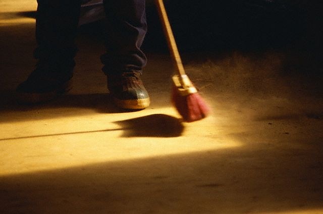 Janitor Sweeping Floor